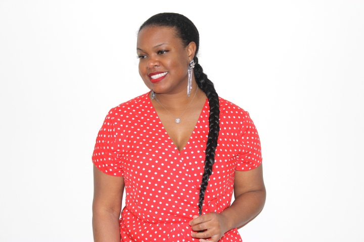 Waist-length​ braided ponytail on natural hair